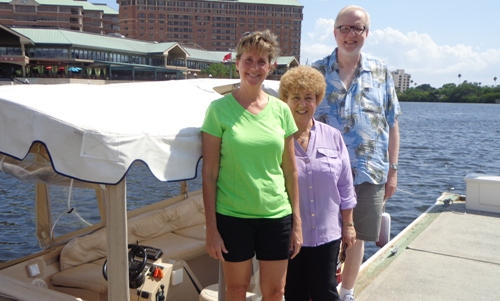 Annual Conference staff Debbie Noffsinger, Chris Douglas, and Jon Kobel standing by an E-boat in Tampa. Photo by Jane Godfrey
