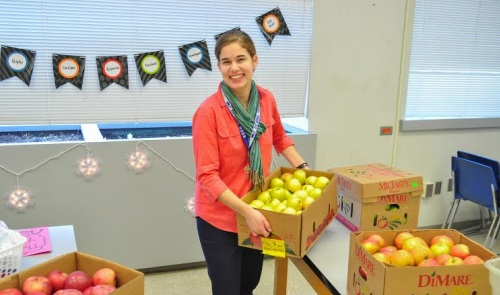 Rachel setting up for the school Pack-a-Snack  program that she coordinates. Photo by Blake Prim