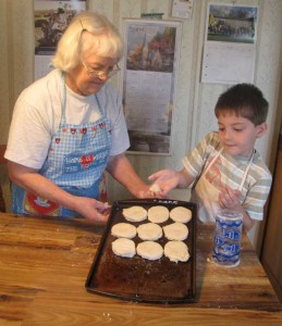 Grandmother baking with grandson