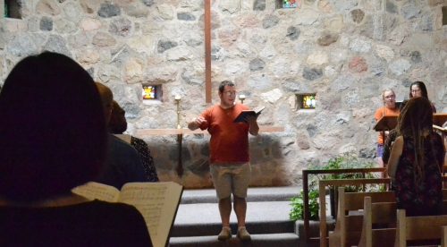Tyler leading chapel at the General Offices. Photo by Cheryl Brumbaugh-Cayford