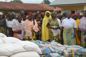Widows wait for relief materials (photo by Donna Parcell at a CCEPI distribution)