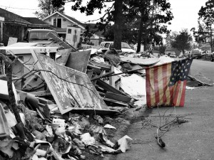 a small sign of hope - a mud-stained and tattered American flag stands in a pile of debris left by Hurricane Katrina in Chalmette, Louisiana