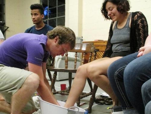 Footwashing among members of Brethren Volunter Service Unit 305. Photo by Ben Bear