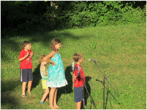Children at the microphone at Song and Story Fest 2014