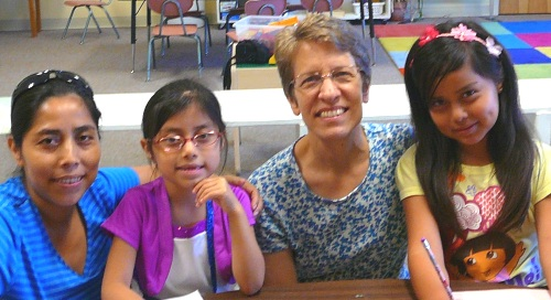 Imelda Velasquez Diaz (first on left) and Nancy Sollenberger Heishman (second from right) serving with the children's ministry at West Charleston Church of the Brethren. Photo by Mary Bowman