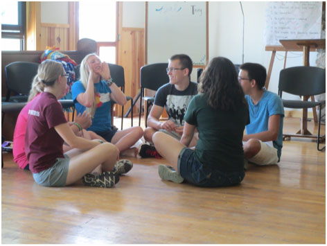 Small group discussion at Camp Pine Lake