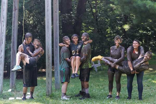 muddy people at Camp Emmaus